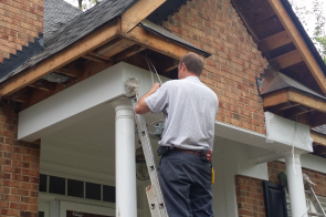 Raleigh Electrician installing wiring for outdoor accent lighting as part of renovation remodeling
